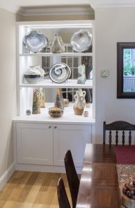 Alcove cupboards with mirror display shelves