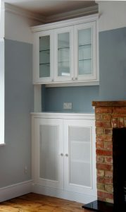 Built in alcove unit with glass doors
