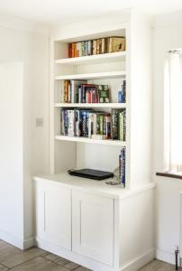 Modern styled alcove unit with panelled doors