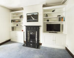 Ornate styled alcove Cupboards with traditional features