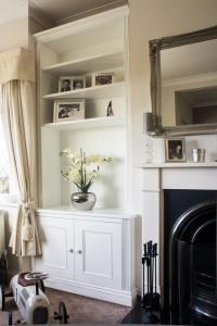 Traditional styled alcove cupboard