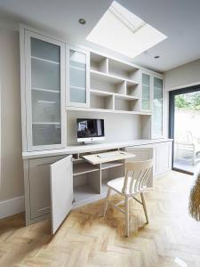 Built in Cabinets with glass doors and occassional home office pull out desk