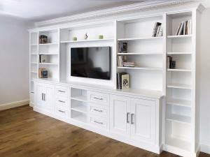 Built in cabinets around TV with shelving