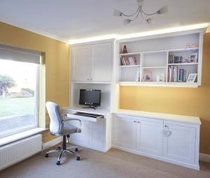 home office with built in cabinets