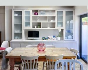 Fitted modern Display and storage cupboards in dining room