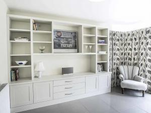 Large Built in unit with shaker doors and central display area and drawers