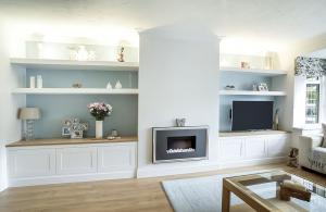 white painted lounge furniture with floating shelves