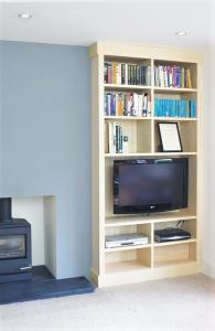built in bookcase with TV in wood