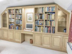 custom made fitted cupboards and shelving in Solid Oak