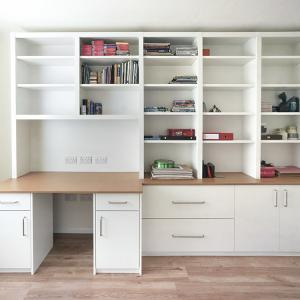 fitted home office with cabinets and shelves