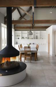 large fitted cabients and shelving in living room barn conversion