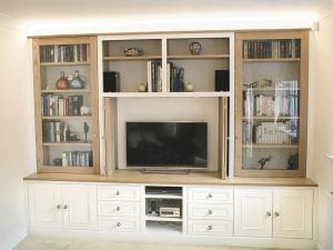 Built in TV unit in traditional design with glass doors