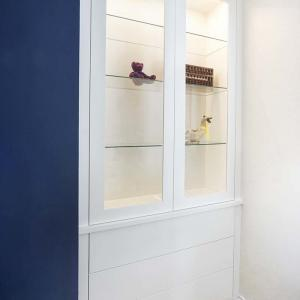Built in cupboards in lounge with glazed doors