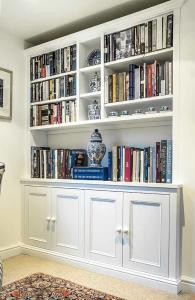 Fitted cabinets and shelving in traditional design