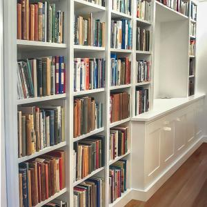 Fitted home library & cabinets in narrow hallway