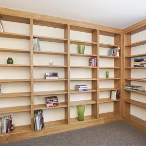 Fitted library in Oak along two walls in a spare room