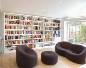 Home Library shelving along wall in bright room