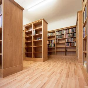 Home library shelving units in converted garage