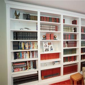 Home library with ornate cornice and fluting detail