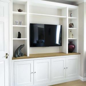 Shaker built in cupboards with space for TV