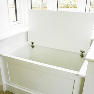 built in windorw seat cupboard