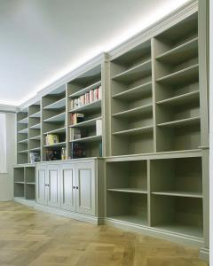 Large wall to wall built in cabinets and bookcases ds in a traditional style painted