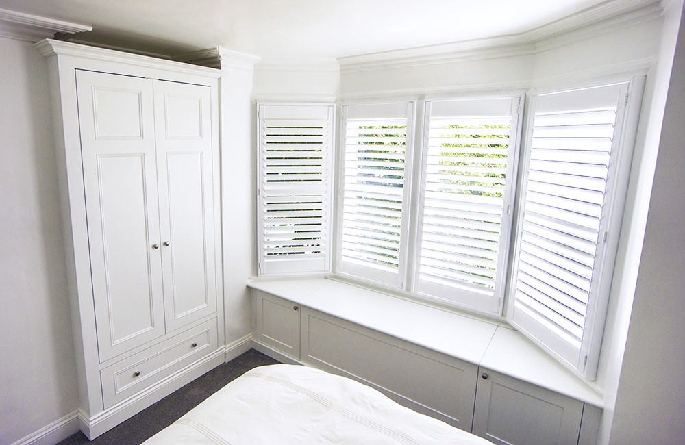 Built in Victorian wardrobes with window seating