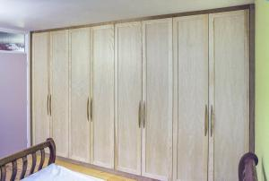 Wooden Built in wardrobe in Ash and Cherry wood