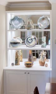 Glass Display cupboard in an alcove