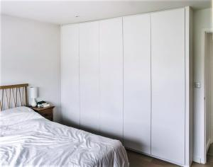 Modern contemporary fitted wardrobes in bedroom