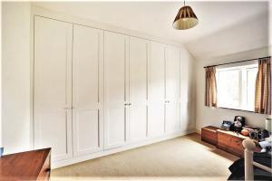 arge wall to wall fitted wardrobe in Bedroom