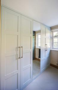 Modern fitted wardrobe with mirror door