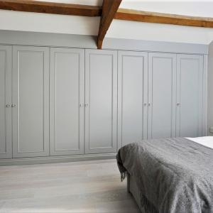 fitted wardrobes wall to wall in grey