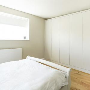 modern contemporary built in wardrobe fitted to bedroom