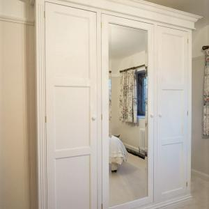 traditionally made Victorian wardrobes with bevelled mirror