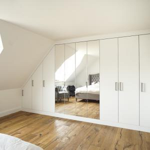 wall to wall modern fitted mirror wardrobe