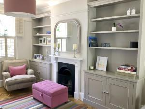 Grey painted alcove cupboards in Oxford period home
