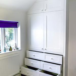 Built in shaker wardrobe with drawers in an alcove