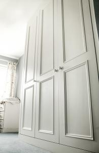 Built in wardrobe with large period panel bead
