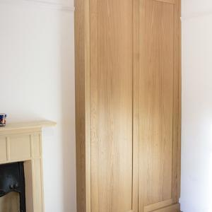 Buitl in alcove wardrobe in Oak