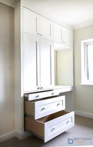 Wardrobes fitted in to an alcove