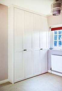 double fitted wardrobe in alcove with period moulding