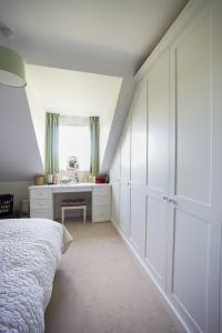 Modern fitted Shaker wardrobe in bedroom