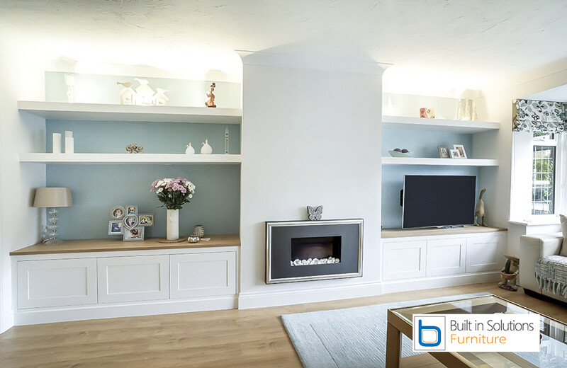 Built-in-cabinets-and-shelving-with-TV-space-with-false-chimney-breast-and-electric-fire