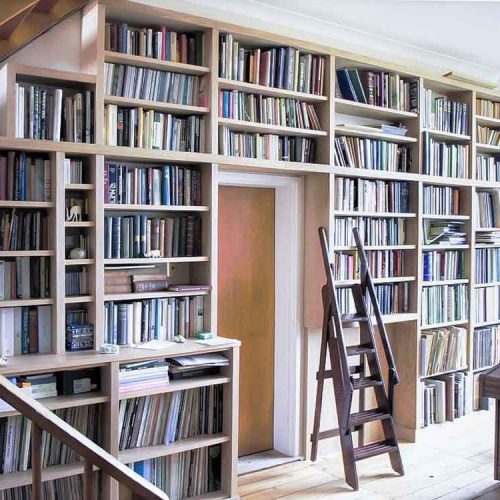 Built in Library bookcases in Oak on large wall