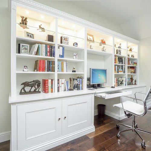 Built in Traditinal style large living room cabients with desk area and glass display shelves with lighting