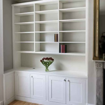 Built in cabinets with triple bookcases with open area fitted in to an alcove (Custom)
