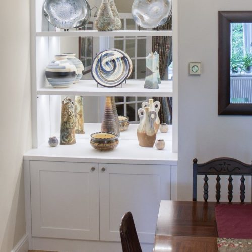 Built in cupboards with display shelving