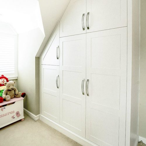 Large Shaker wardrobe under eves in this room makes the best use of this space.