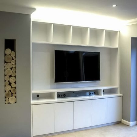 Contemporary built in media cabinets in an alcove